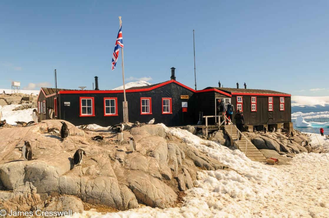 A photograph of the Penguin Post Office and former British base at Port Lockroy on Goudier Island, Antarctica, taken on a PolarWorld Travel expedition cruise