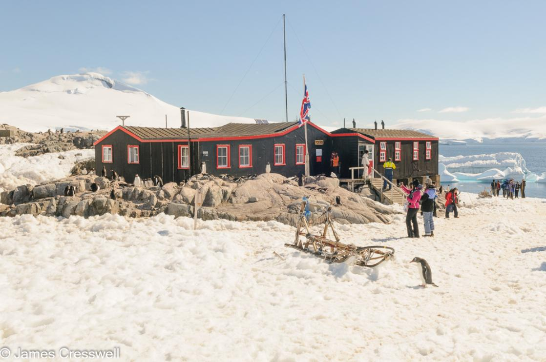 A photograph of the British hut the Penguin Post Office at  Port Lockroy on Goudier Island, Antarctica, taken on a PolarWorld Travel expedition cruise