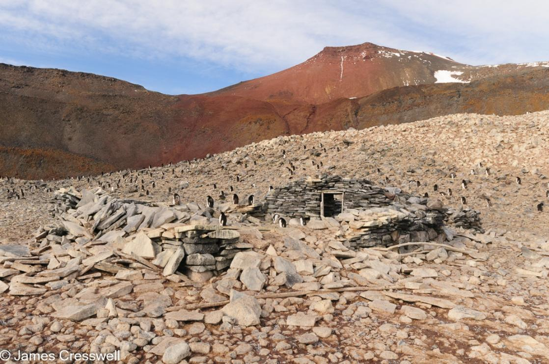 A photograph of the remains of  Nordenskiöld's hut, Paulet Island, Weddell Sea, Antarctica, taken on a PolarWorld Travel expedition cruise